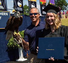 Photo of a graduate with her diploma